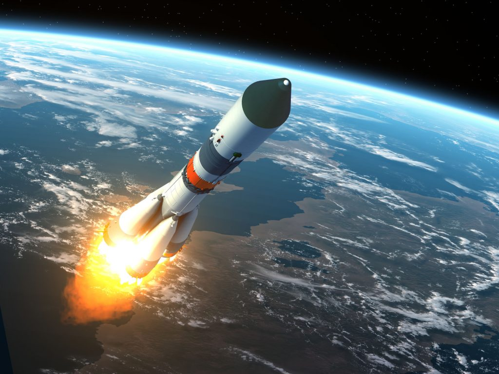 Image of launching rocket entering space.