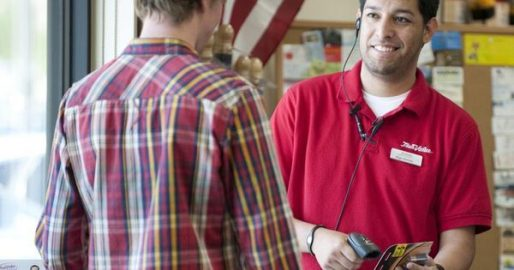 Image of 2 men at a hardware store one is a employee the other is a customer.