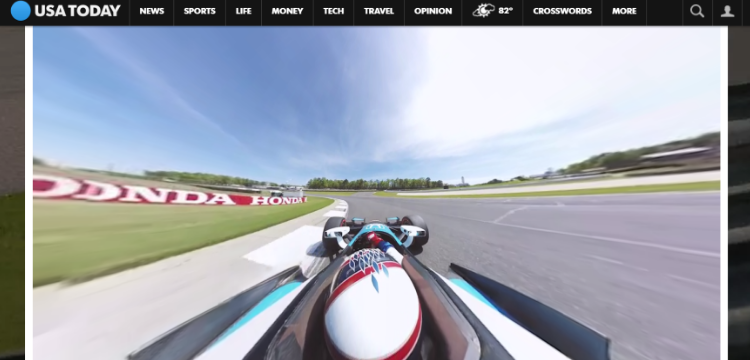 Image of racing car driving around a racing track.