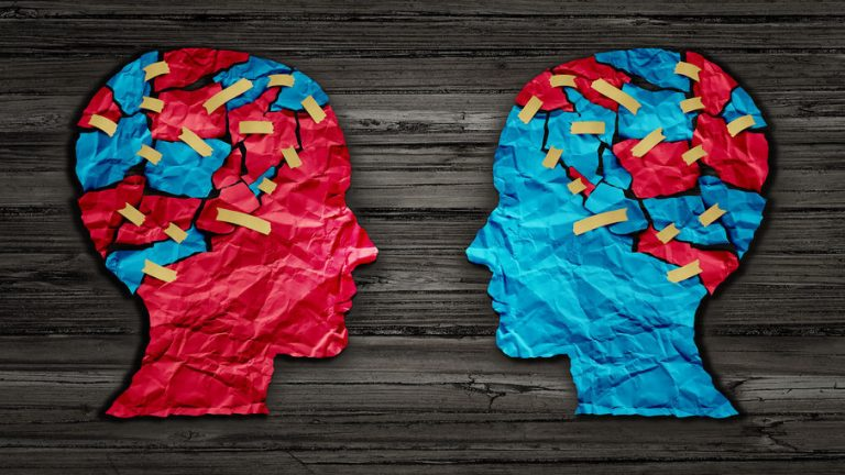 Image of two heads facing each other with there brains showing.
